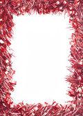 Red Christmas tinsel garland — Stock Photo