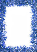 Blue Christmas tinsel garland — Stock Photo