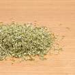 Pile of dried parsley on wooden worktop — Stock Photo
