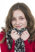 Young girl posing with scarf held to chin — Stock Photo