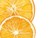 Two slices of dried orange on white background — Stock Photo