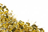 Gold tinsel and bead decoration border on white — Stock Photo