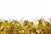 Gold tinsel decoration border on white — Stock Photo