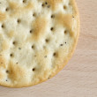 One round cracker on wooden board — Stock Photo