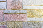 Decorative stone cladding on house wall — Stock Photo