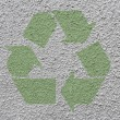 Green recycle symbol on stucco walll — Stock Photo