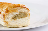 Sausage roll on a white plate — Stock Photo