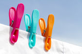 Three clothes pegs on a line — Stock Photo