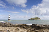 Lighthouse and Puffin Island at Penmon Point — Stock Photo