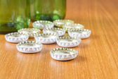 Beer bottles with white caps — Stock Photo