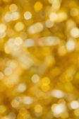 Abstract gold blurred lights christmas background — Stock Photo