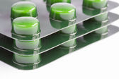 Stack of green pills in blister packs — Stock Photo