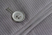 Close up pocket button on formal suit trousers — Stock Photo