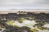 Beach at low tide at Rhosneigr in Anglesey, Wales — Stock Photo