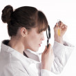 Stock Photo: Scientist with magnify glass