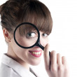 Stock Photo: Womwith magnify glass