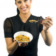 Woman with a bowl of muesli — Stock Photo