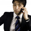 Asian businessman making a call — Stock Photo