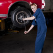Changing a tire - Stock Photo
