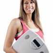 Woman in pink top with scales — Stockfoto