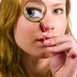 Stock Photo: Goldy Locks with magnify glass