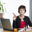 Mature businesswoman looking up — Stock Photo