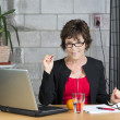 Mature businesswoman looking at you — Stock Photo #33207363