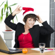 Mature businesswoman with Christmas hat — Stok fotoğraf