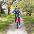 Unicycle girl — Stock Photo