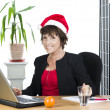 Mature businesswoman with hat — Stock Photo