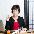 Mature businesswoman  with pen — Stock Photo