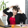 Mature businesswoman with Christmas headset — Stock Photo