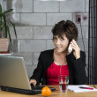 Calling mature businesswoman — Stock Photo