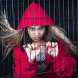 Red and caged — Stok fotoğraf