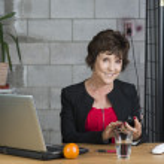 Mature businesswoman with calculator — Stock Photo