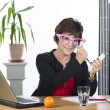 Funny mature businesswoman with phone being weird — Stock Photo