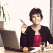 Mature businesswoman smiling at you — Stock Photo
