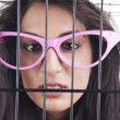 Crossed eyed in a cage — Stock Photo