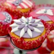 Foto Stock: Tasty cupcake on standard