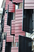Wooden shutters on Amsterdam houses — Stock Photo