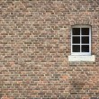 Brick wall with window — Lizenzfreies Foto