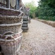 Stack of baskets along a path — Stock Photo