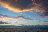 Cloudscape and contrails above the dutch sea — Stock Photo