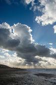 Cloudscape above the dutch sea with sunbeams — Stock Photo