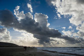 Cloudscape above the dutch sea with sunbeams — Stock Photo