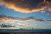 Cloudscape and contrails above the dutch sea — Stock Photo