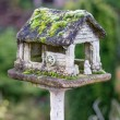Old vintage birdhouse in garden — Stock Photo