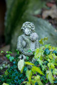 Stone figurine female with child — Stock Photo