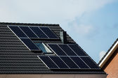 Solar panels on house roof — Stock Photo