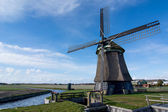 Old windmill against blue sky — Stock Photo